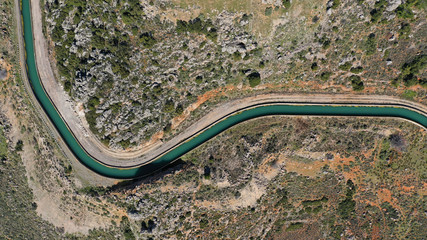 Aerial drone top view photo of snake curvy winding road built in steep mountain slope