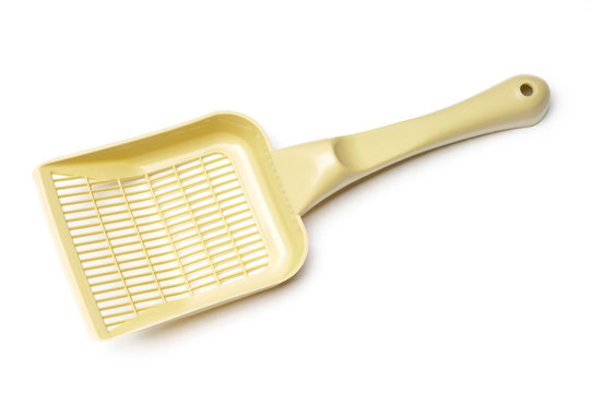 A yellow plastic pooper scooper to clean cat's or dog's excrements
