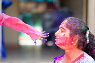 Fashion Model Girl colorful face paint. Beauty fashion art portrait of beautiful woman girl with flowing liquid paint holi, abstract makeup