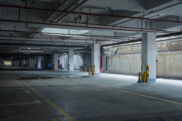 old parking lot with lighting, concrete building