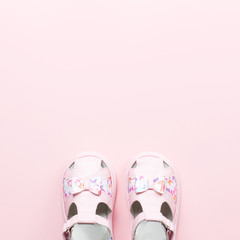 Baby girls accessories - sandals, toys. Childhood concept flat lay.