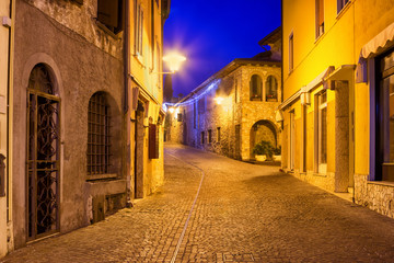 Old night street in Sirmione, Garda lake, Lombardy, Italy. Architecture and houses in Sirmione.