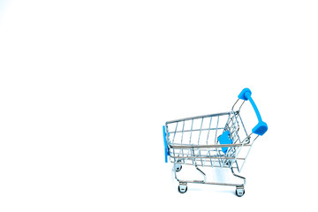 Shopping cart isolated on white background. Minimal concept. Space for text on the left side of frame