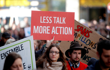 People attend a demonstration asking for urgent measures to combat climate change, in Paris