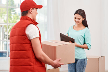 Every contact we have with a customer influences whether or not they ll come back. Woman signing receipt of delivery package.