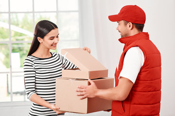 Go beyond merely communicating to 'connecting' with people. Young woman receiving parcels from delivery man