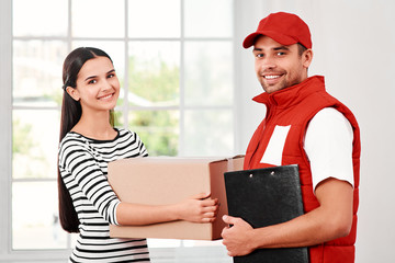 Flawless customer service facilitates opportunity more than anything else. Young woman receiving parcel from delivery man