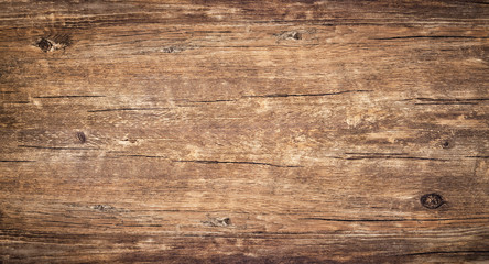 Photo sur Plexiglas Bois Wood texture background. Surface of old knotted wood with nature color, texture and pattern. Top view of weathered vintage wooden table with cracks. Brown rustic rough wood for backdrop.