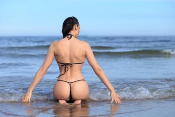 woman with sporty body in bikini
