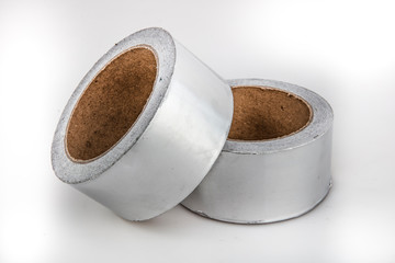 Adhesive aluminum foil tape for padding on white background.