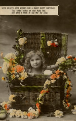 Little Girl in Basket, with Flowers