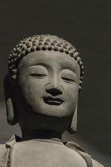 closeup face of buddha statue.