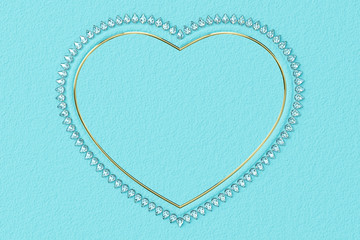 Heart-shaped frame made of small diamonds and glossy gold on turquoise textured background