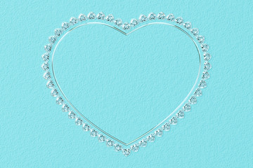 Heart-shaped frame made of small diamonds and glossy silver on turquoise textured background