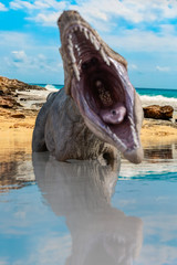 Tyrannosaurus on the beach with face out of focus