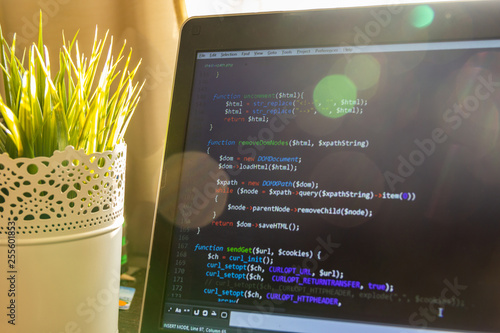 Abstract web developer background  PHP scraper code in sun light