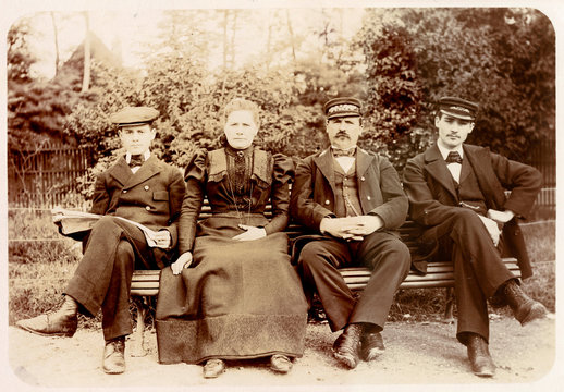 Four People on a Bench in a Garden