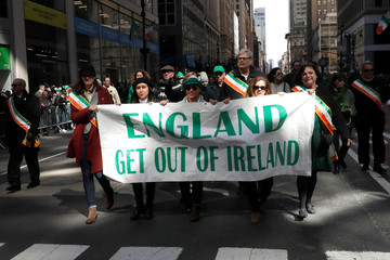 Members of the Brehon Law Society carry a banner as they march in the 258th St Patrick's Day Parade in New York