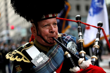 A man plays the bagpipes as he marches in the 258th St Patrick's Day Parade in New York