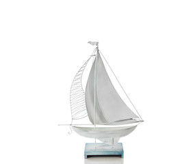 Sailboat made of metal isolated on a white background