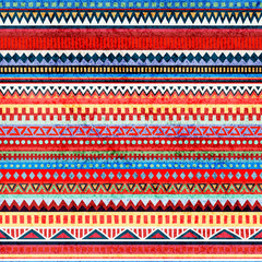 Striped seamless pattern. Ethnic and tribal motifs. Grunge texture. Blue, red, yellow and gray colors. Vector illustration.