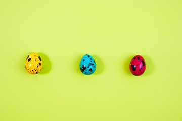 a row of colored painted quail eggs for Easter