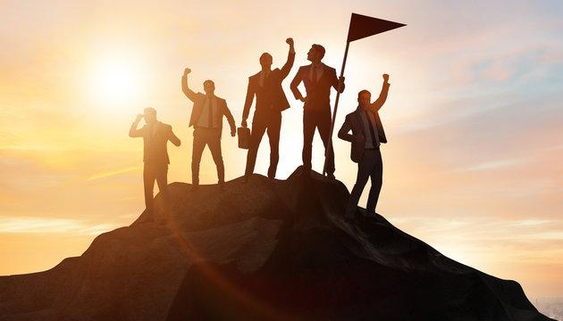 Businessmen in achievement and teamwork concept