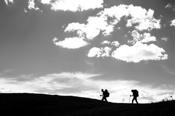 Two hikers walking along the mountain trail