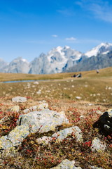 Caucasus Mountains landscape with blurred people on background