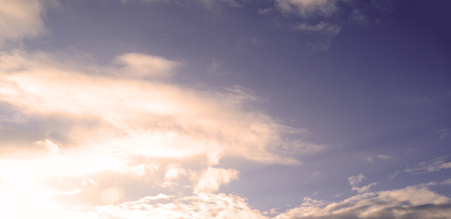 Sky background with white clouds. Natural texture.