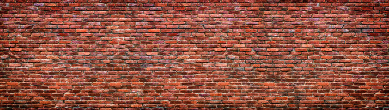 Old brick wall background. Panoramic texture of red stone.