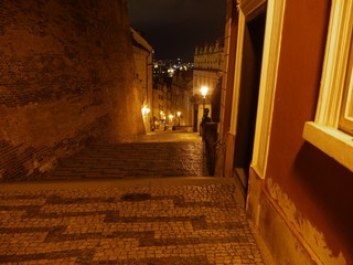 a pathway in Prague at night