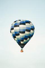 Blue hot air balloon in the clear sky