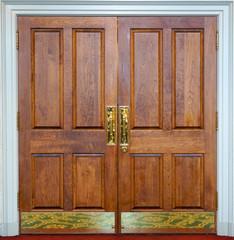 facade view of closed classic wooden brown door