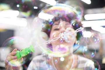 software developer having fun while making soap bubble
