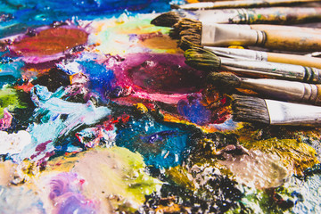 Color fragments stained on paper sheets from art and paint brushes