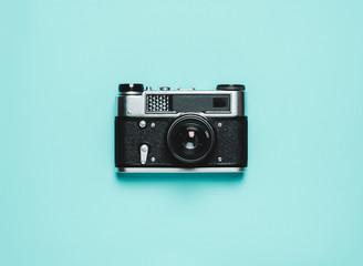 old Vintage photo camera on a blue background