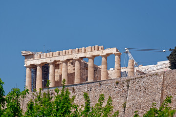 Athens, Parthenon ancient Greek temple, view from the street under the hill