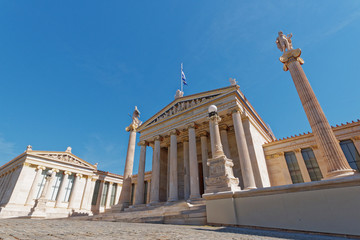 national academy of Athens Greece, extreme perspective of the main colonade with Athena and Apollo statues