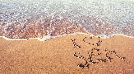 Happy holidays and travel concept. Sea beach and hand drawing text I love sea