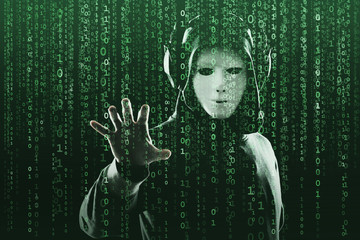 Anonymous computer hacker over abstract digital background. Obscured dark face in mask and hood. Data thief, internet attack, darknet fraud, dangerous viruses and cyber security. Fototapete