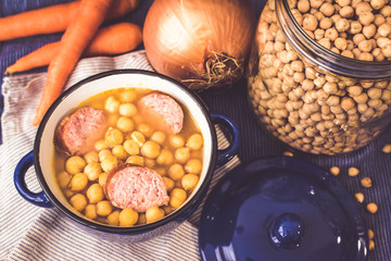 chickpeas stew. Cocido of garbanzo background.