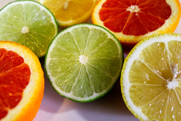 Citrus fruit halves. Lemons, limes and oranges
