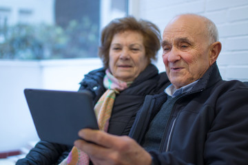 older couple with laptop, exercises and memory