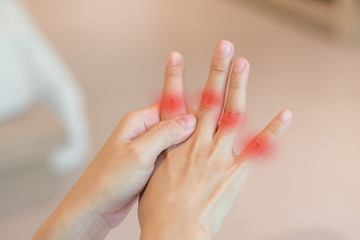 Overuse hand problems. Woman's hand with red spot o fingers as suffer from Carpal tunnel syndrome. The symptoms of tingling, numbness, weakness, or pain of the fingers and wrist.