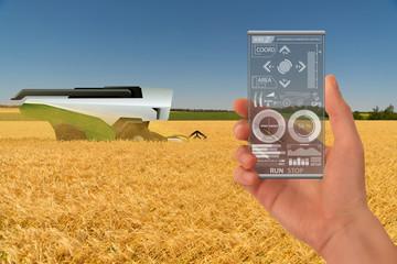 Etiqueta Engomada - Farmer uses a futuristic smartphone to control autonomous harvester. Smart farming concept