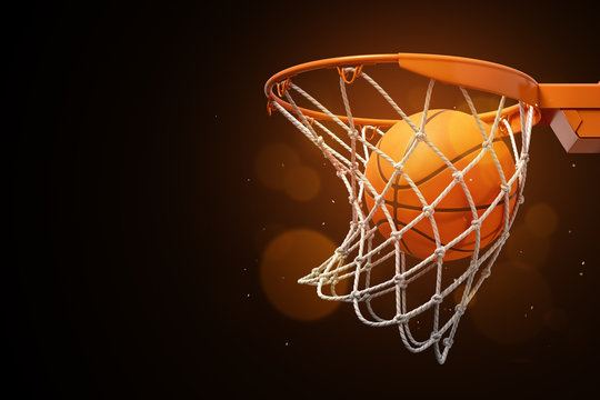 3d rendering of a basketball in the net on a dark background.