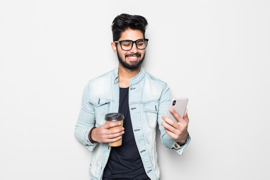 Portrait of young happy Indian man making video call from the phone isolated on white background