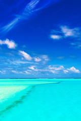Sandbank with turquoise water and blue sky, Aitutaki island, Cook Islands, South Pacific. Copy space for text.