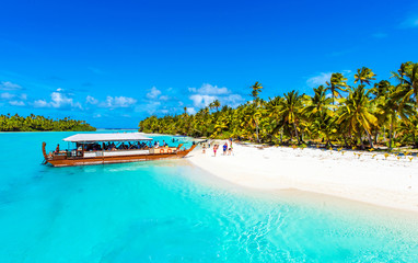 Boat on a sandy beach in Aitutaki island, Cook Islands, South Pacific. Copy space for text.